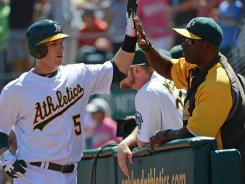 A's shortstop Stephen Drew high-fives batting coach after his first homer with the team Sunday in a 6-2 win vs. the Red Sox.