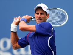 Defending champion Novak Djokovic of Serbia rolls into the fourth round with a 6-3, 6-2, 6-2 victory Saturday against Julien Benneteau of France.