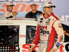 Denny Hamlin clinched at least a share of the No. 1 seed in the Chase for the Sprint Cup with his fourth victory.