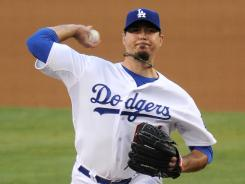 Josh Beckett pitched six-plus innings to snap a career-high five-game losing streak.