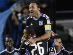 Ramiro Corrales, top, celebrates one of his two goals with teammate Victor Bernardez.