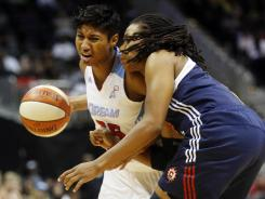 Dream guard Angel McCoughtry tries to get around Sun guard Tan White during Atlanta's 87-80 win Sunday.