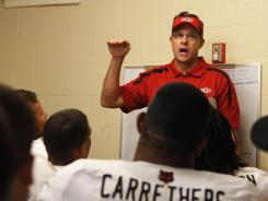 Gus Malzahn addresses his team in the Arkansas State locker room after losing to Oregon 57-34.