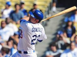 Dodgers first baseman Adrian Gonzalez hits a two run RBI double to bring in the winning runs in the ninth inning Sunday vs. the Diamondbacks.