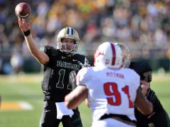 Baylor quarterback Nick Florence (11) throws a touchdown pass during the firs quarter against SMU.
