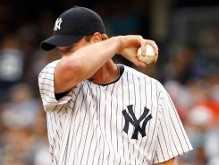 Yankees reliever Derek Lowe shows his dismay after walking in a run in an 8-3 loss Sunday to the Orioles.