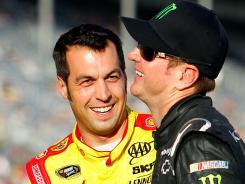 Sam Hornish Jr., left, shares a laugh with Kurt Busch on Friday at Atlanta Motor Speedway. Hornish is driving the No. 22 Dodge that Busch drove last year for Penske Racing.