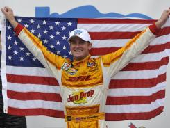 Ryan Hunter-Reay celebrates after winning the Grand Prix of Baltimore.