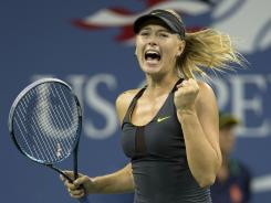 Maria Sharapova pumps her fist, as she did many times Sunday night, during her three-set victory against Nadia Petrova.