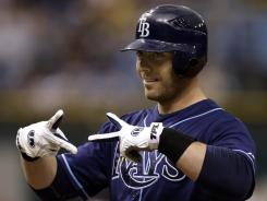 Rays' Chris Gimenez reacts to the dugout after his eighth-inning RBI single off Yankees' David Robertson.