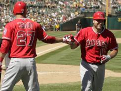 Angels catcher Chris Iannetta, right, is congratulated by outfielder Mike Trout after hitting a home run in the sixth inning.