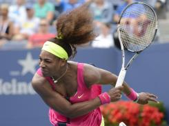 Serena Williams of the USA hammers a serve during her blowout victory againstAndrea Hlavackova of the Czech Republic at Arthur Ashe Stadium on Monday.