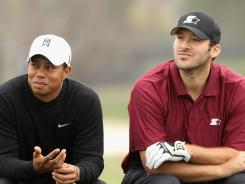 Tiger Woods and NFL football quarterback for the Dallas Cowboys, Tony Romo wait on the sixth tee during the second round of the AT&T Pebble Beach National Pro-Am at the Monterey Peninsula Country Club (Shore Course) in February in Pebble Beach, Calif.