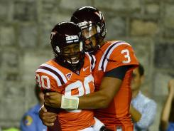 Logan Thomas (3) celebrates his fourth-quarter touchdown pass to Demitri Knowles (80).