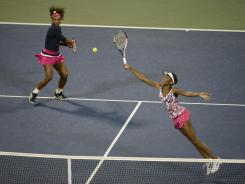 Serena Williams and Venus Williams were ousted Monday in doubles by the No. 4 seeds, Maria Kirilenko and Nadia Petrova of Russia.