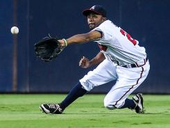 Tight races: Outfielder Michael Bourn and his Braves are among a glut of teams in the National League that could finish with identical records.