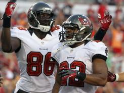Buccaneers running back Doug Martin, shown after a preseason touchdown Aug. 24 vs. the Patriots, could explode in his first NFL game against the weak Panthers run defense.
