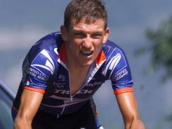 Cyclist Tyler Hamilton, shown here in the 2001 Tour de Suisse, says Lance Armstrong was heavily involved a doping conspiracy while the two were teammates on the U.S. Postal Service team. 'Lance worked the system - hell, Lance was the system,' Hamilton writes in a new book on doping in cycling.