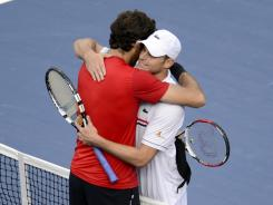 Andy Roddick gets an embrace from Juan Martin del Potro after del Potro defeated Roddick in a fourth-round match Wednesday at the U.S. Open.