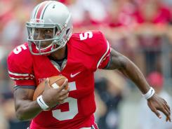 Quarterback Braxton Miller and the rest of the Ohio State Buckeyes still could earn a trophy this season as champion of the Big Ten Leaders Division.