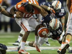 Clemson quarterback Tajh Boyd had to sit out three plays Saturday, including the one following this run, after losing his helmet three times against Auburn.