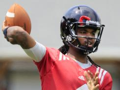 Cincinnati quarterback Munchie Legaux, shown here during a practice in August, hopes to exploit holes in Youngstown's defensive front in their game Thursday.