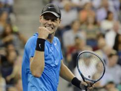 Tomas Berdych pumps his first after winning the second set Wednesday night. The Czech star beat top-ranked Roger Federer in four sets to advance to the semifinals.