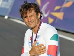Alex Zanardi wears the gold medal he won Wednesday in the men's H4 individual time trial during the London 2012 Paralympic Games.