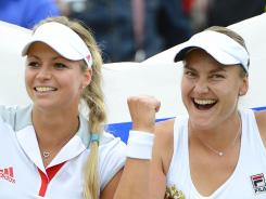 Maria Kirilenko and Nadia Petrova, who won bronze in the Olympics, are into the quarterfinals at the U.S. Open.