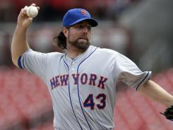 Mets' R.A. Dickey became the first pitcher in the majors to win 18 games this season.