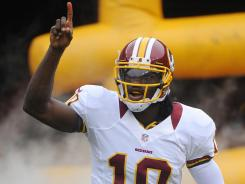 "Rookie Robert Griffin III, above, ""had the confidence from the beginning,"" teammate Josh Morgan said."