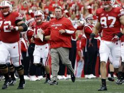 Coach Bret Bielema will take Wisconsin into battle Saturday night at Oregon State in Corvallis.