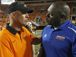 Oklahoma State coach Mike Gundy, left, and Savannah State coach Steve Davenport, discuss OSU's 84-0 win last week.