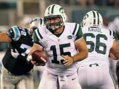 Aug 26, 2012; East Rutherford, NJ, New York Jets quarterback Tim Tebow (15) looks to hand off during the fourth quarter against the Carolina Panthers at Met Life Stadium. Panthers won 17-12. Mandatory Credit: Anthony Gruppuso-US PRESSWIRE ORG XMIT: USPW-82356 ORIG FILE ID: 20120826_ajl_ag9_371.jpg