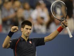 Novak Djokovic celebrates after beating Juan Martin Del Potro 6-2, 7-6 (7-3), 6-4 Thursday in the U.S. Open quarterfinals.