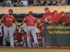 "Good times: The Angels celebrate Alberto Callaspo's home run against the A's in the fifth inning Tuesday. ""We're having a lot more fun,"" Torii Hunter said. ""We've definitely progressed."""