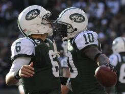 Jets QB Mark Sanchez (6) seems to have the faith and respect of teammates like WR Santonio Holmes despite the team's Tebow-centric offseason.