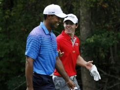 Tiger Woods and Rory McIlroy share a laugh Thursday during the first round of the BMW Championship at Crooked Stick Golf Club in Carmel, Ind.