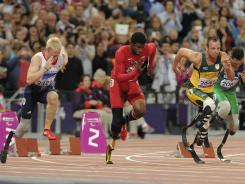 Jonnie Peacock, left, of Great Britain, starts out in Thursday's Paralympic Games 100 meters, along with the USA's Richard Browne, center, and Oscar Pistorius of South Africa. Peacock won the gold, Browne finished second and Pistorius fourth.