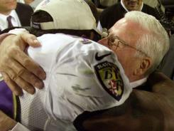 Super Bowl MVP Ray Lewis hugs Ravens' owner Art Modell after their victory in Super Bowl XXXV.