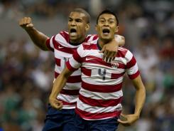 Terrence Boyd, left, celebrates with Michael Orozco Fiscal after the latter's game-winning goal vs. Mexico on Aug. 15.