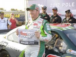 Dale Earnhardt Jr. celebrates after winning the pole for Saturday night's Sprint Cup regular-season finale at Richmond International Raceway.