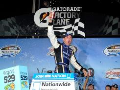 Kevin Harvick celebrates in victory lane after winning the Virginia 529 College Savings 250 Friday night at Richmond International Raceway.