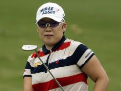 Jiyai Shin of South Korea eyes her putt on the ninth green during the first round of the Kingsmill Championship.