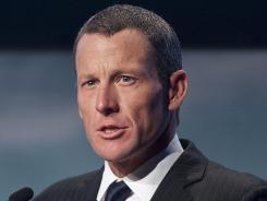Lance Armstrong speaks to delegates at the World Cancer Congress.