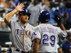 Rangers third baseman Adrian Beltre, right, congratulates Ian Kinsler after scoring the go-ahead run in the 10th inning Thursday vs the Royals. Texas won 5-4.