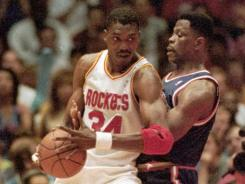 Hakeem Olajuwon, left, had many battles with Patrick Ewing and other franchise centers on his way to the Hall of Fame.