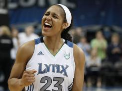 Maya Moore, who scored a team-high 23 points, celebrates after the Lynx rallied to beat the Dream 97-93 in double overtime.