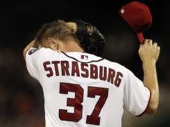 Stephen Strasburg was pulled after three innings, giving up six hits including two home runs and five earned runs, walking three Marlins.
