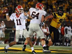 Georgia quarterback Aaron Murray (11) led the Dawgs past Missouri in the second half to spoil the Tigers' SEC debut.